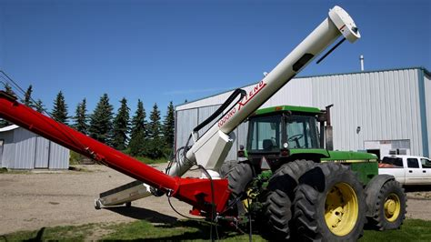 swing auger beulah machinery retracting swing auger