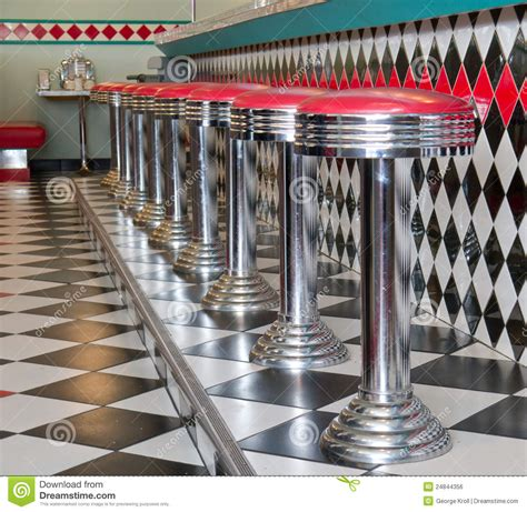 50s Style Bar Stools by Counter Stools In A Row At A 50 S Style Diner Royalty Free