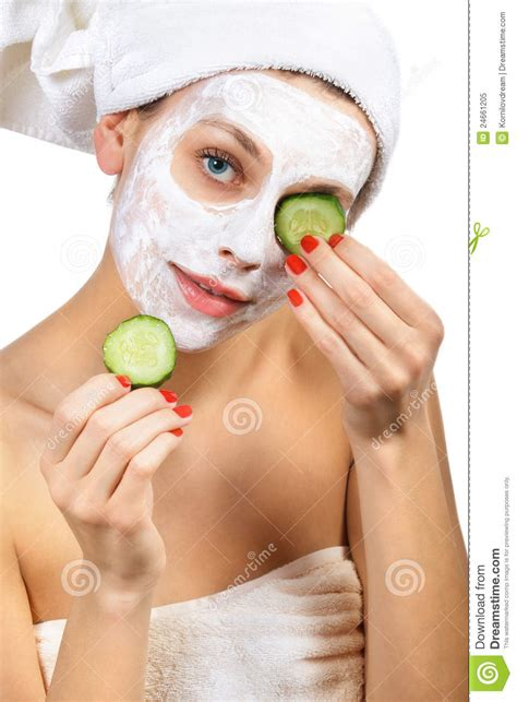 girl with cucumber girl with a mask and cucumber royalty free stock photo
