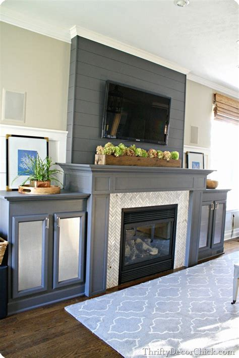 a gorgeous gray fireplace complete with diy built ins and