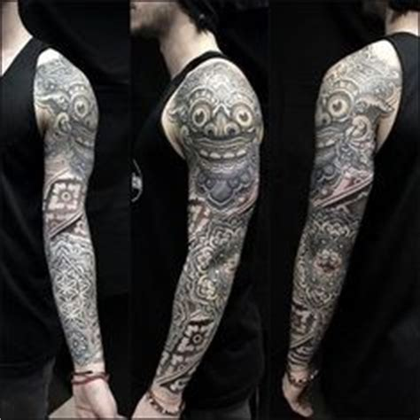 celtic and bali inspired sleeve by meatshop tattoo on balinese barong tattoo www travelling bali com get inked