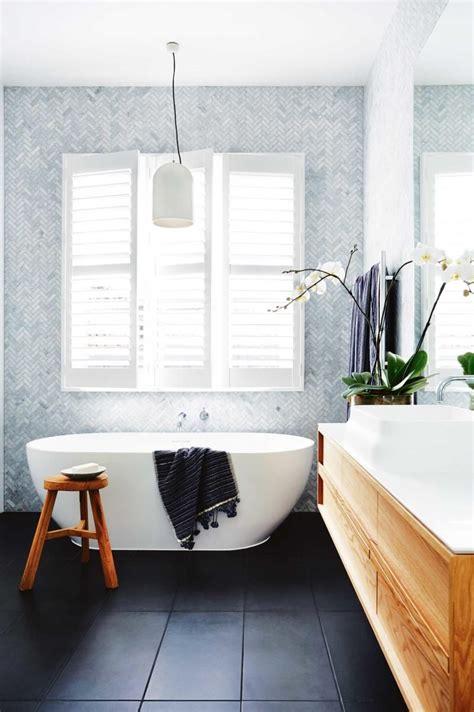 Stunning herringbone tiles in this bathroom   Bathroom