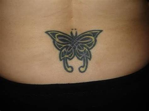 small butterfly tattoo on back