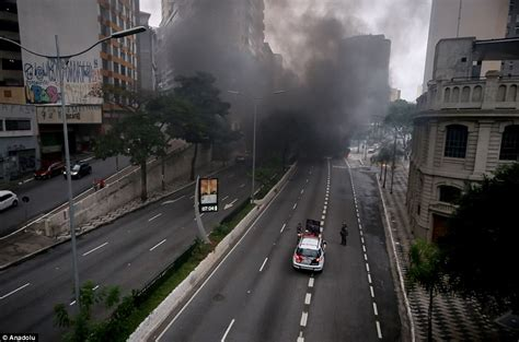 brazilians clash with during national strike