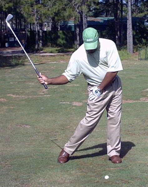 hip turn in golf swing drill use the hitman drill to feel a great right hip turn in the