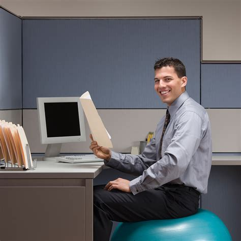 Man Sitting At A Desk Words On Wellness 187 Fitness