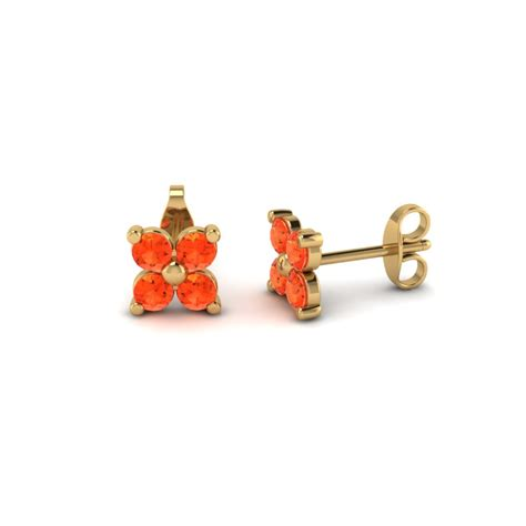 yellow gold poppy topaz stud earrings in prong set