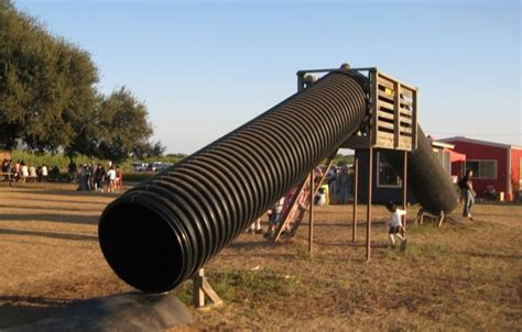 a slide made out of what looks like culvert pipe show