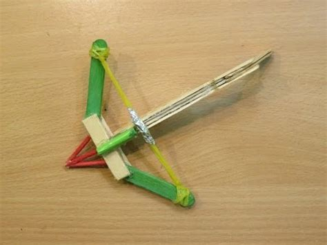 how to make a mini crossbow using pop stick home made