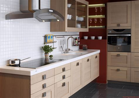 Kitchen Interior White Wooden Cabinet With Shelves And Drawers Combined With Sink And Black Counter Top Placed On