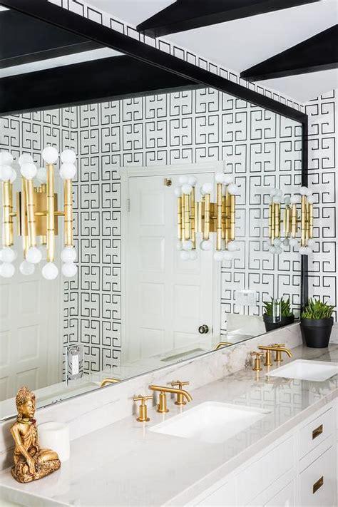 white and black bathroom with greek key wallpaper
