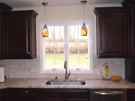 over kitchen sink lighting over the sink lighting ideas homesfeed