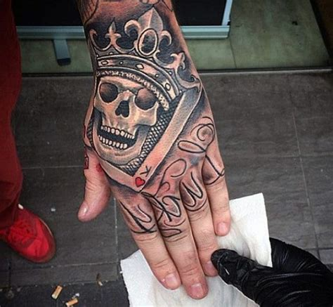 crown hand tattoo enthralling with smiling skull and crown on
