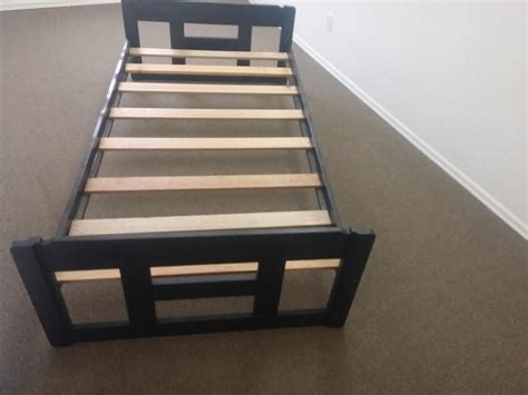 great condition single black bed frame with wooden slots no box requires outside