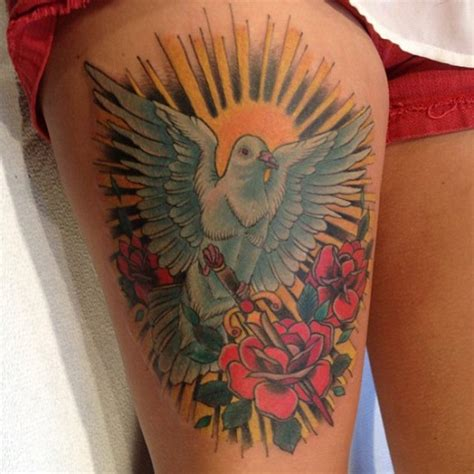 dove with rose tattoo dove and on thigh