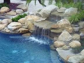 pool fountains and waterfalls rock waterfall and pond into swimming pool contemporary