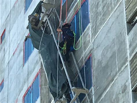 sarasota rescue crews trying to rescue worker stuck on scaffolding in sarasota county wptv