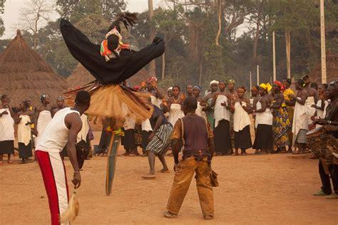 ivory coast traditional dance stilt dance ceremony ivory coast overlanding west africa