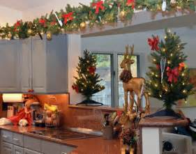 kristmas decorations on top of kitchen cupboards house