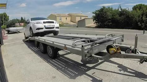 location d une remorque porte voiture technique d arrimage d une voiture sur la remorque