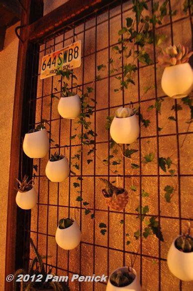 vertical metal grid  hanging egg planters filled