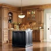 Plaza cherry whiskey black glaze by thomasville cabinetry