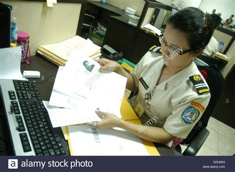 Immigration Officer by An Immigration Official Process E Passport At Immigration