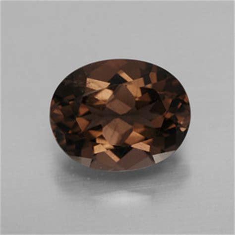 oval facet chocolate brown smoky quartz gemstone image
