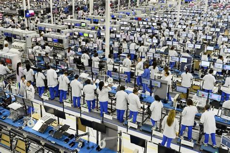apple factory report examines labor violations at apple supplier s