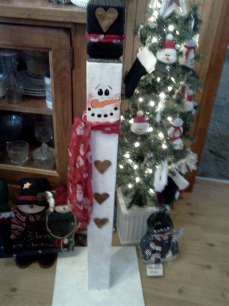 ideas for decorating iron fence posts for christmas snowman made out of fence post crafts snowman craft and snowmen ideas