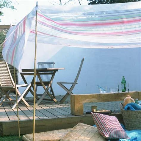 alfresco dining area with with shade sail canopy