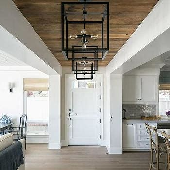 hallway with pecky cypress ceiling cottage entrance foyer hallway with weathered plank ceiling transitional