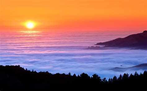 sunset fog  sea mountains  wall paper