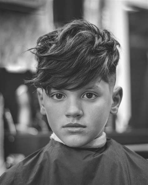 side swept boys hairstyles 31 cutest boys haircuts for 2018 fades pomps lines more