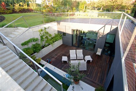 backyard floor plans with basement entry house plan playing geometrically sloping house exterior narrow site