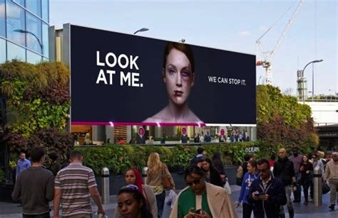 domestic violence billboard dares people not to look away battered woman billboard quot heals quot as more people look at