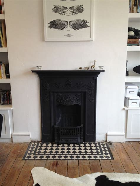 a home called new a celebration of hearth and history books cast iron fireplace gives a warm touch to the
