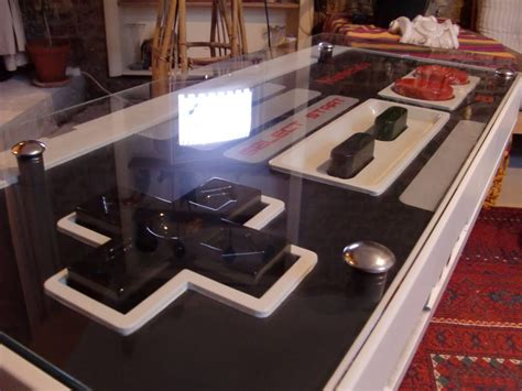 a functional nintendo nes controller coffee table