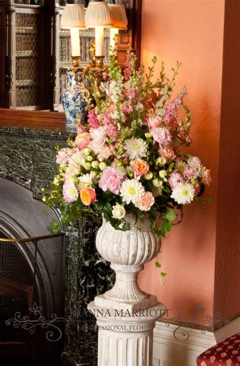 pale pink pedestal arrangement wedding ceremony flowers pedestal