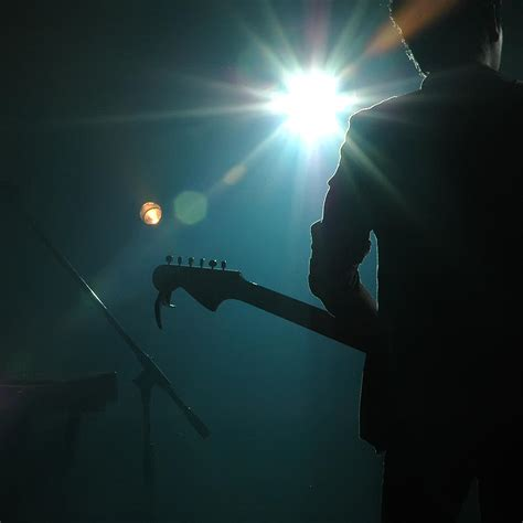 Band Guitarist guitarist of a pop band photograph by phanlop