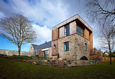 modern house in country scottish country house incorporates ruins of a former mill