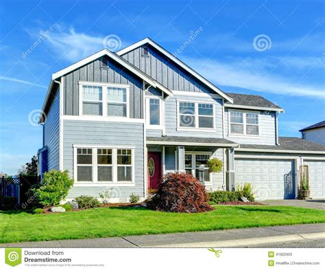 two story big two story house view of entance porch and garage stock photo image 41822903