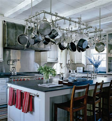 kitchen island with hanging pot rack pot rack over kitchen island dining table eclectic kitchen