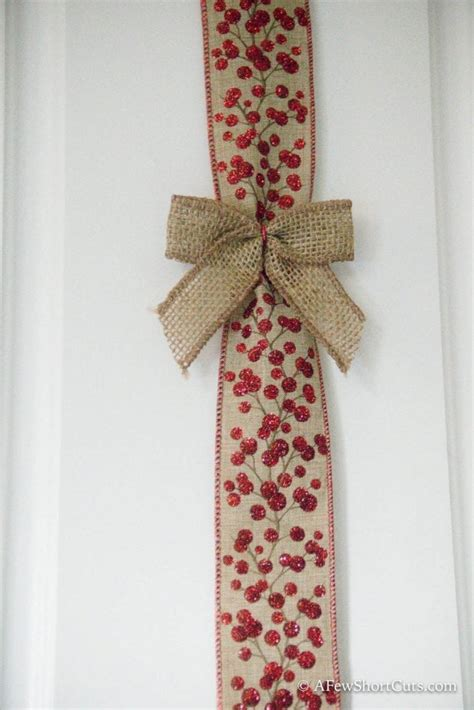christmas bows on kitchen cabinets christmas cabinet ribbon decorations a few shortcuts