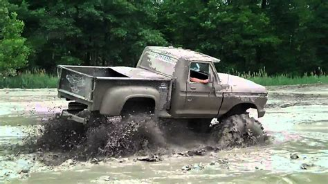 truck mudding big black ford truck 4x4 mudding