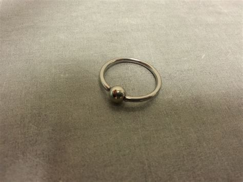 how to change a captive bead ring captive bead ring removal the axiom piercing studio
