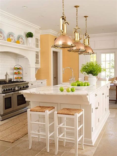 yellow and white kitchen cabinets white kitchen cabinets and marble with yellow walls