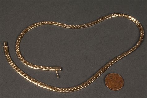 lot 170 14k yellow gold serpentine necklace 31 9 grams