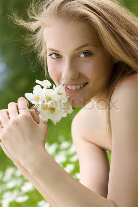 beautiful teen portrait of beautiful teen girl with white flowers in the