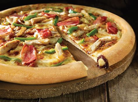 domino pizza new york crust half price pizzas on offer as domino s opens new branch in